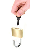 Hand unlocking padlock Royalty Free Stock Photography