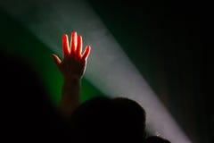 Hand up light beam, crowd people. stock photos