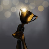 Hand up trophy. Hand up golden trophy design on gray background Royalty Free Stock Photography