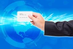 Hand use credit card. In the world Stock Photography