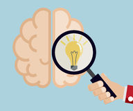 Hand use magnifier for find idea from brain Stock Photography