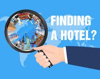 Hand use magnifying glass find hotel for travel. A hand use magnifying glass find hotel for travel Royalty Free Stock Photos