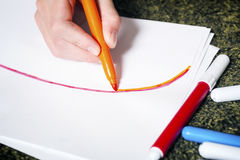 Hand use orange highlight pen Stock Photo