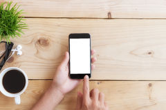Hand use phone on wood table Royalty Free Stock Images