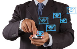 Hand use smart phone computer with email icon Stock Images