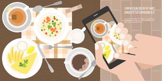 Hand use smartphone take photo by touching screen before eating in restaurant in aerial view Royalty Free Stock Image
