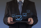 Hand use tablet computer with email icon Royalty Free Stock Images