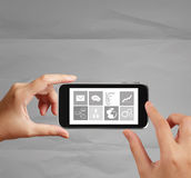 Hand use Touch screen mobile phone Royalty Free Stock Photos