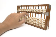 Hand using abacus Royalty Free Stock Images
