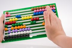 Hand using an abacus Stock Photos