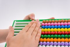 Hand using an abacus Stock Photo
