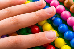 Hand using an abacus Stock Images