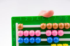 Hand using an abacus Royalty Free Stock Photography