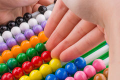Hand using an abacus Royalty Free Stock Image
