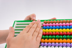 Hand using an abacus Royalty Free Stock Photo