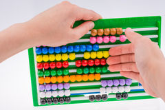 Hand using an abacus Royalty Free Stock Images