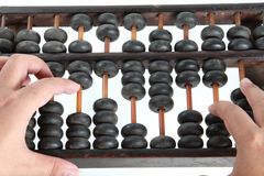 Hand using abacus Royalty Free Stock Photography