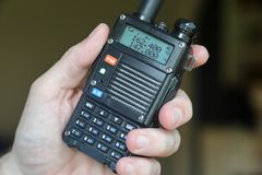 Hand using amateur radio walkie talkie. Used for communications during emergencies or for general talking among friends stock photos