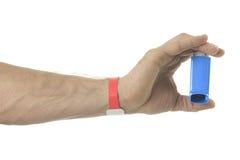 Hand using an asthma inhalator Royalty Free Stock Photo