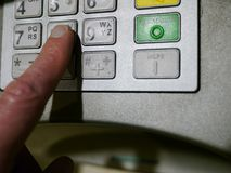 Hand Using ATM Keyboard stock photos