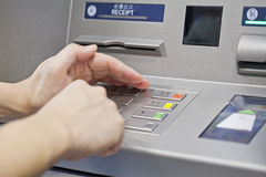 Hand using atm machine Royalty Free Stock Images