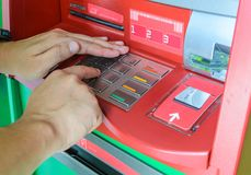 Hand using atm machine Royalty Free Stock Photo