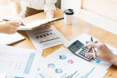 Hand using calculating focus, Professional business team investor and financial working in office ,Business marketing concept royalty free stock photography