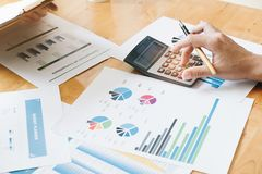 Hand using calculating focus, Professional business team investor and financial working in office ,Business marketing concept royalty free stock image