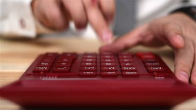 Hand Using Calculator. Accountant Hand Using Red Calculator. Business Concept. Close Up stock video footage
