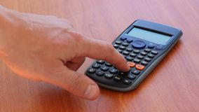 Hand using calculator. Lying on a table stock video footage
