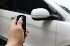 Hand using car key to open the car Royalty Free Stock Photography
