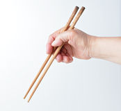 Hand using chopsticks Royalty Free Stock Photo
