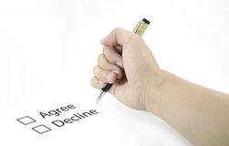 Hand using a classic pen decide to choice accept or decline Royalty Free Stock Photography