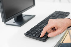 Hand using computer keyboard Royalty Free Stock Image