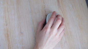 Hand using computer mouse. Hand using a computer mouse. Close up stock video