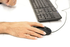 Hand using computer mouse Royalty Free Stock Images