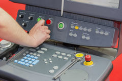 Hand using control panel of a cnc machine Royalty Free Stock Photography