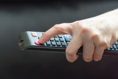 Hand using control remote Stock Image