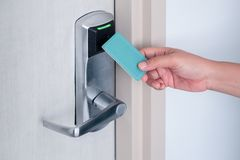 Free Hand Using Electronic Smart Contactless Key Card For Unlock Door In Hotel Or House Royalty Free Stock Images - 158775309