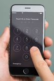 Hand Using Enter Passcode Application On Apple iPhone6 Royalty Free Stock Photo
