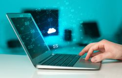 Hand using laptop with centralized cloud computing system concept royalty free stock images