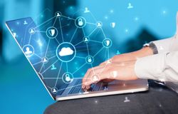 Hand using laptop with centralized linked cloud system concept. Hand using laptop with centralized cloud computing system and network security conceptn royalty free stock image