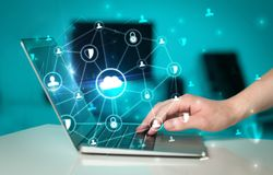 Hand using laptop with centralized linked cloud system concept. Hand using laptop with centralized cloud computing system and network security conceptn stock image