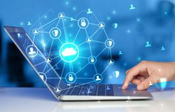 Hand using laptop with centralized linked cloud system concept. Hand using laptop with centralized cloud computing system and network security concept stock photos