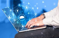 Hand using laptop with centralized linked cloud system concept. Hand using laptop with centralized cloud computing system and network security conceptn royalty free stock images