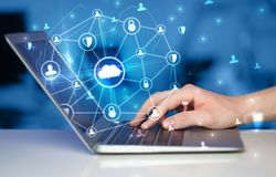 Hand using laptop with centralized linked cloud system concept. Hand using laptop with centralized cloud computing system and network security concept stock photo