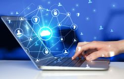 Hand using laptop with centralized linked cloud system concept. Hand using laptop with centralized cloud computing system and network security concept royalty free stock images