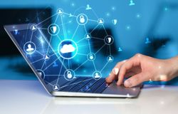 Hand using laptop with centralized linked cloud system concept. Hand using laptop with centralized cloud computing system and network security concept stock photography