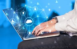 Hand using laptop with centralized linked cloud system concept. Hand using laptop with centralized cloud computing system and network security conceptn royalty free stock photography