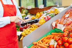 Hand using mobile data acquisition. Hand of salesperson using mobile data acquisition terminal in a supermarket royalty free stock photos